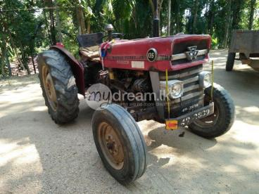 MF 135 tractor with trailer